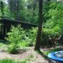 achterzijde huisje met trampoline